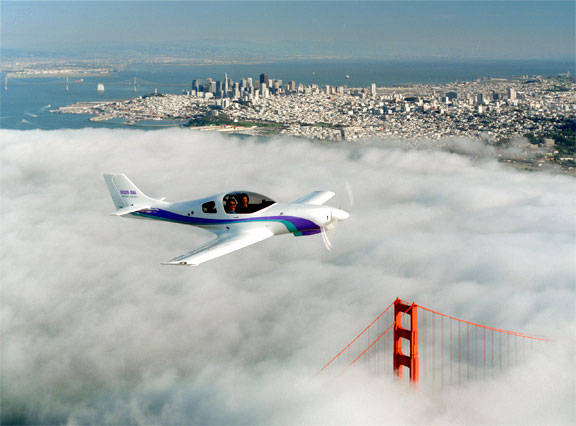 Lancair kitplane over the Golden Gate Bridge